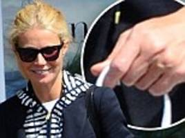 Gwyneth Paltrow spotted without wedding ring after putting it back on following split with Chris Martin